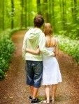 1320792-a-portrait-of-a-sweet-couple-in-love-a-walk-in-the-forest-